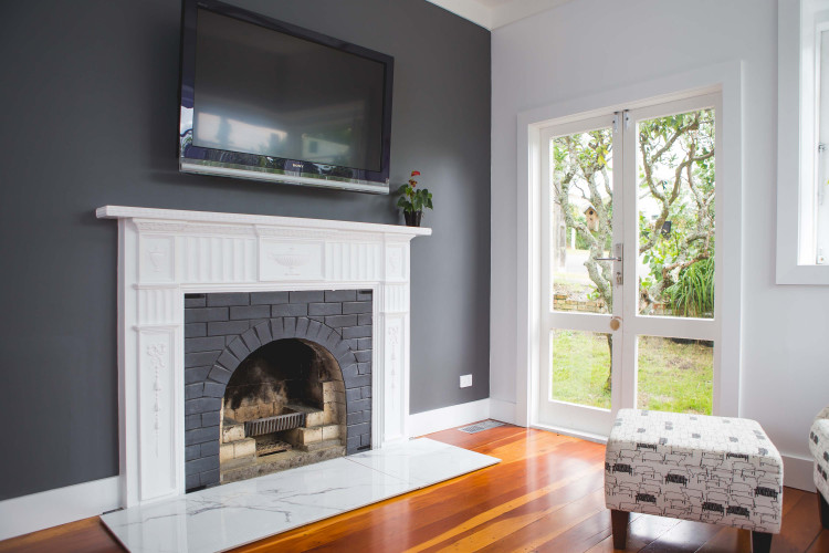 lounge, living room, fireplace, grey living room, grey feature wall, white and grey lounge