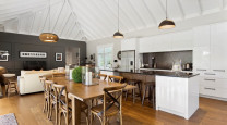 A classically-styled Matarangi bach makes the most of open-plan living photo