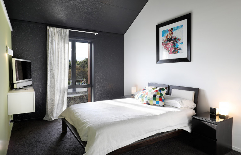 bedroom, black and white bedroom, green feature wall, black bedroom, resene nocturnal
