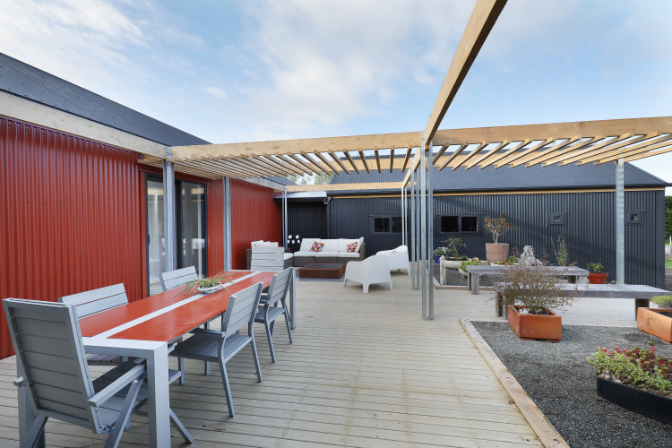 house exterior, deck, corrugated iron exterior, outdoor living, outdoor dining, red exterior