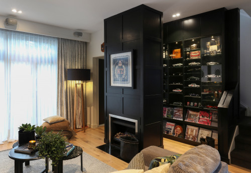 black fireplace, fireplace, black and white, lounge, living room, black feature wall