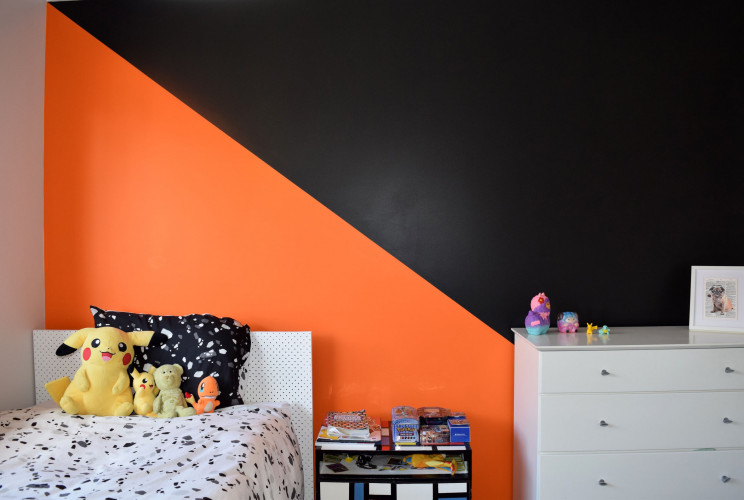 orange feature wall, orange and black, kids room, boys room, resene adrenalin, resene all black