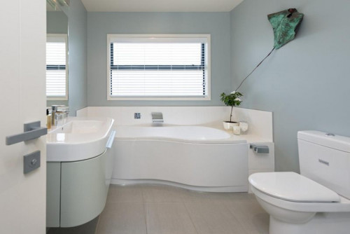 blue bathroom, beach house, white cabinetry, interior