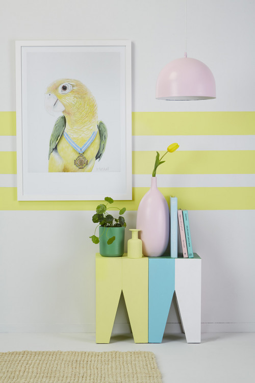 parrot artwork, yellow striped wall, striped feature wall, yellow lounge, parrot print