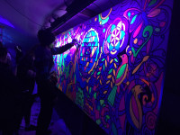 Denise sets the stage for an unforgettable fluoro mural