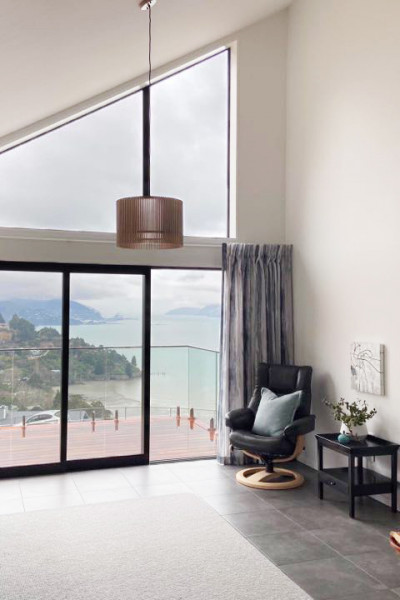 This Governors Bay home uses a clever colour trick to link two storeys together and fill the home with warm light (that's not too bright)